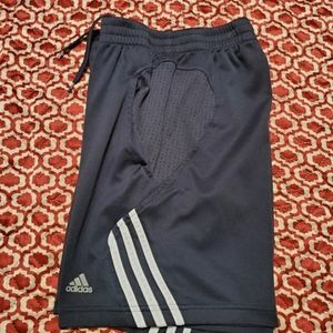 Adidas boys shorts are size Medium